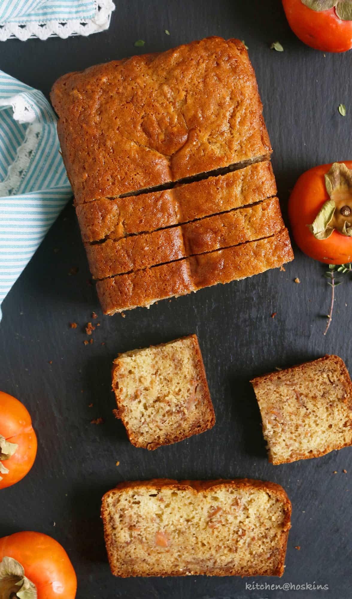 sliced healthy persimmon bread on a black board