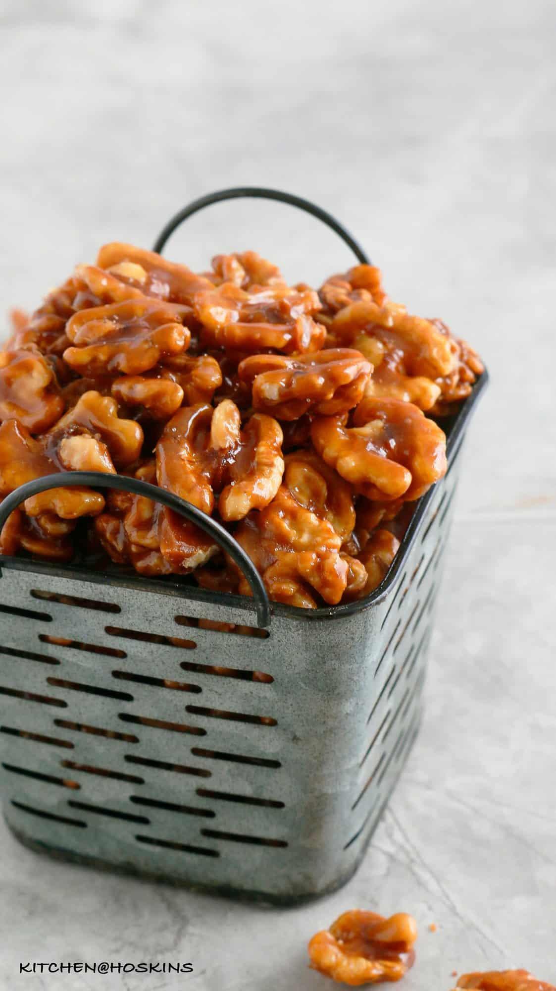 square enamel basket filled with CARAMEL WALNUTS