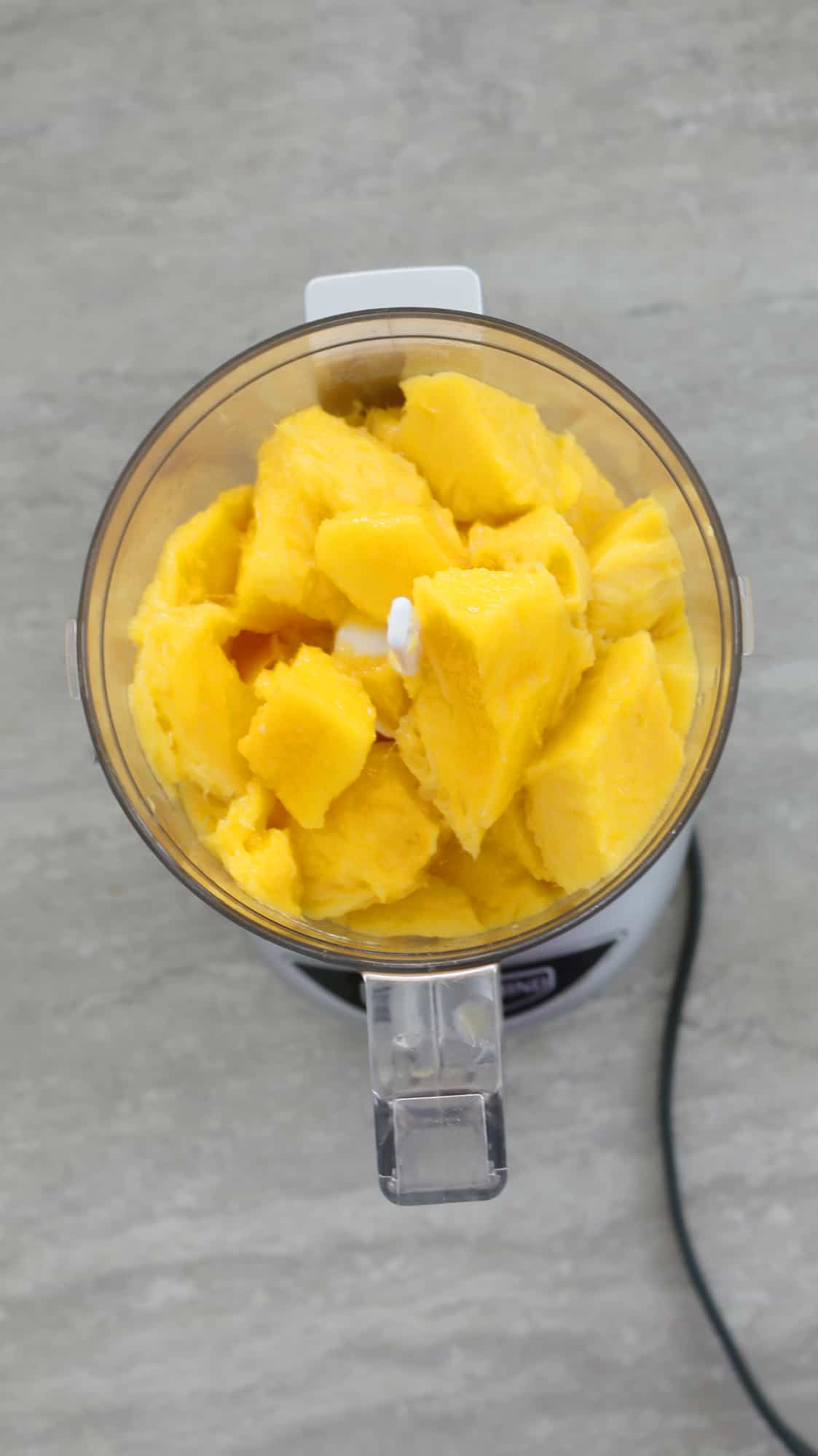chopped mangoes in food processor