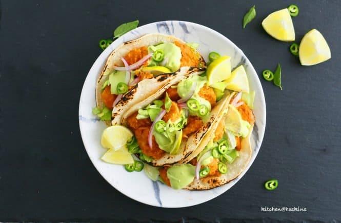 buffalo shrimp tacos with avocado jalapeno crema
