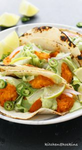 buffalo shrimp tacos with avocado jalapeno crema
