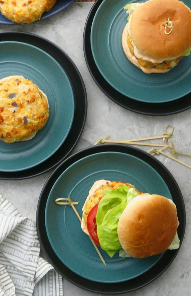 oven baked chicken burgers on green plates