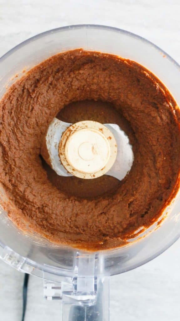 smooth hummus made with dates in a food processor