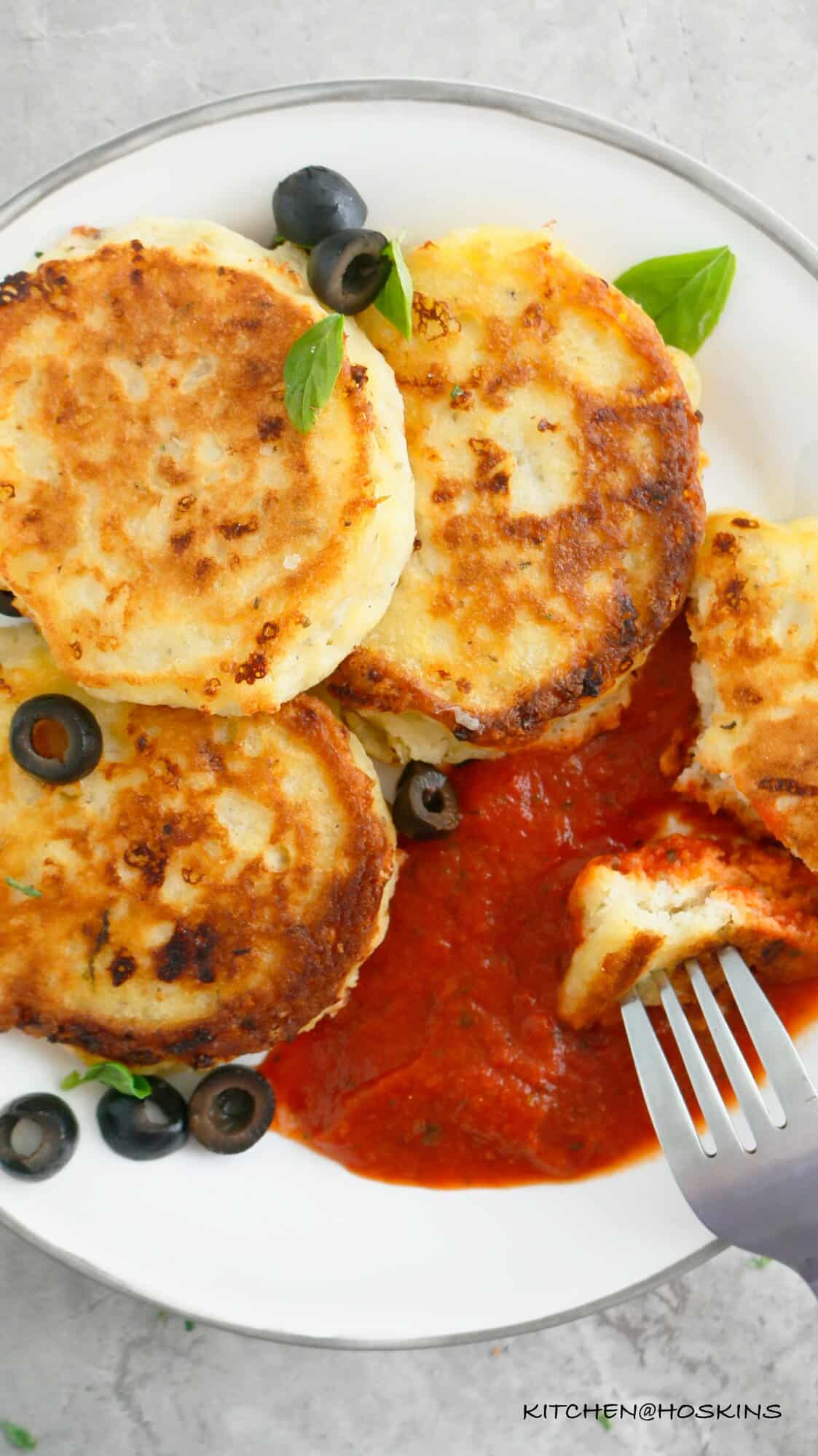 homemade savory pancakes with pizza toppings and served with marinara sauce