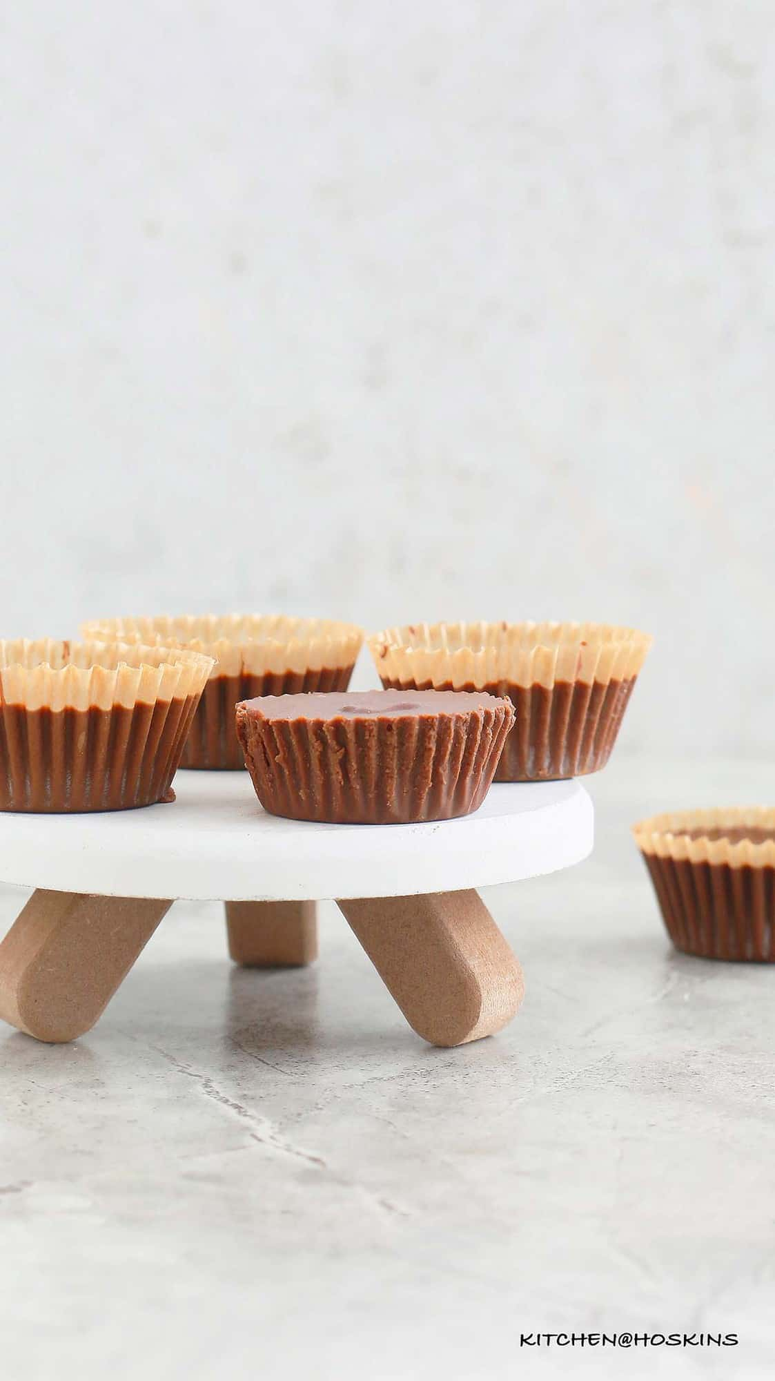 homemade almond butter cups placed on a small stand