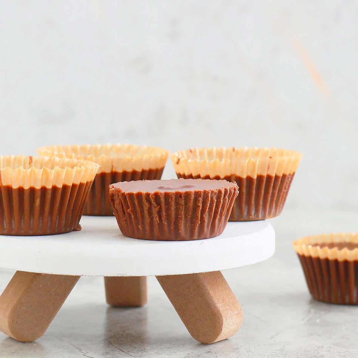 homemade almond butter cups on a small stand
