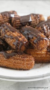 deep fried churros with chocolate sauce