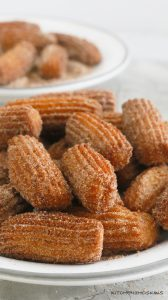 hot deep fried churros coated with cinnamon sugar