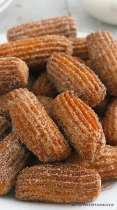 hot deep fried churros coated with cinnamon sugar