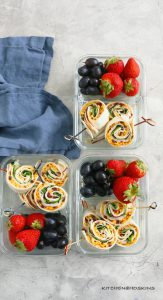 turkey apple and cheddar pinwheels in a lunch box