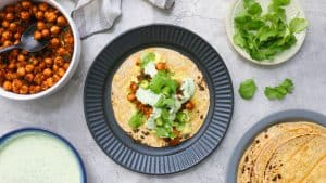 charred corn tortilla with Mexican chickpeas, cilantro sauce, avocado, lettuce and jalapenos