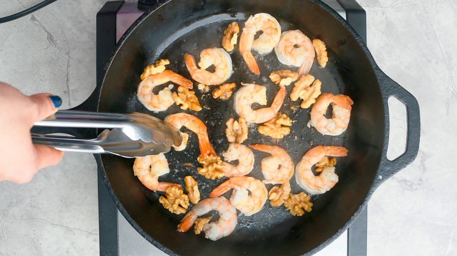 cooked shrimp and walnut in a pan