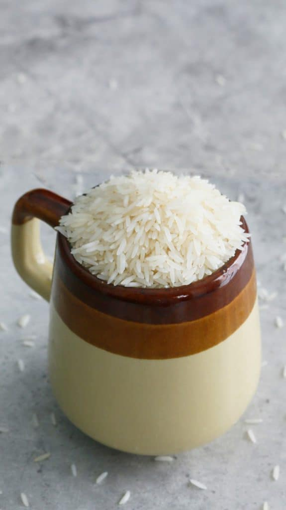 mug full of white basmati rice