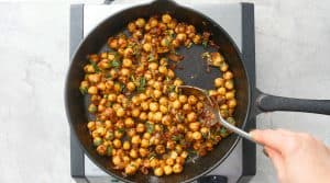 stir chopped cilantro and lime juice with chickpeas