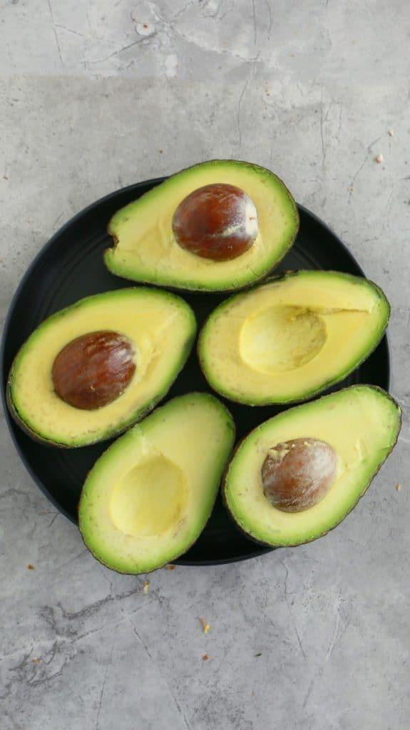 a bowl of cut avocados