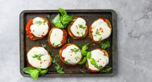 caprese salad on bread with pesto