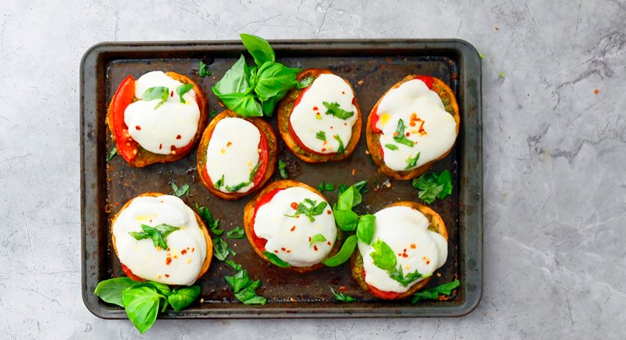 caprese salad on bread with pesto