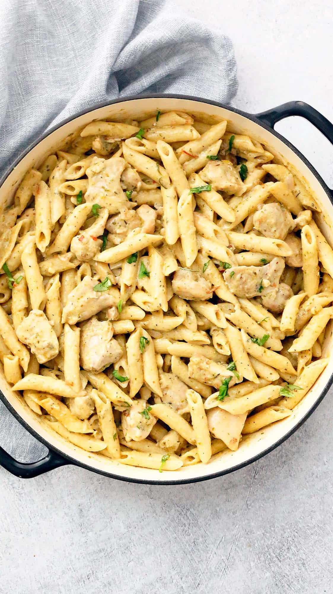 cast iron pan with chicken pasta with pesto cream sauce