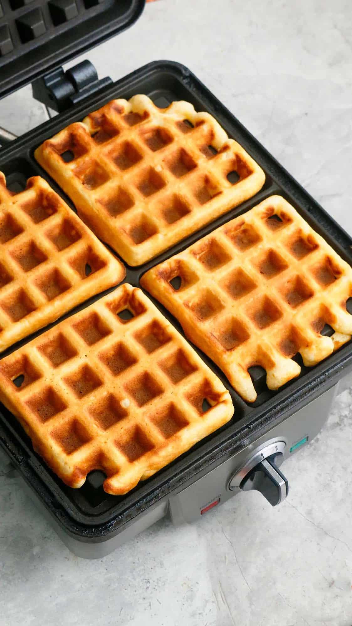 hot Belgian waffles on a waffle iron.