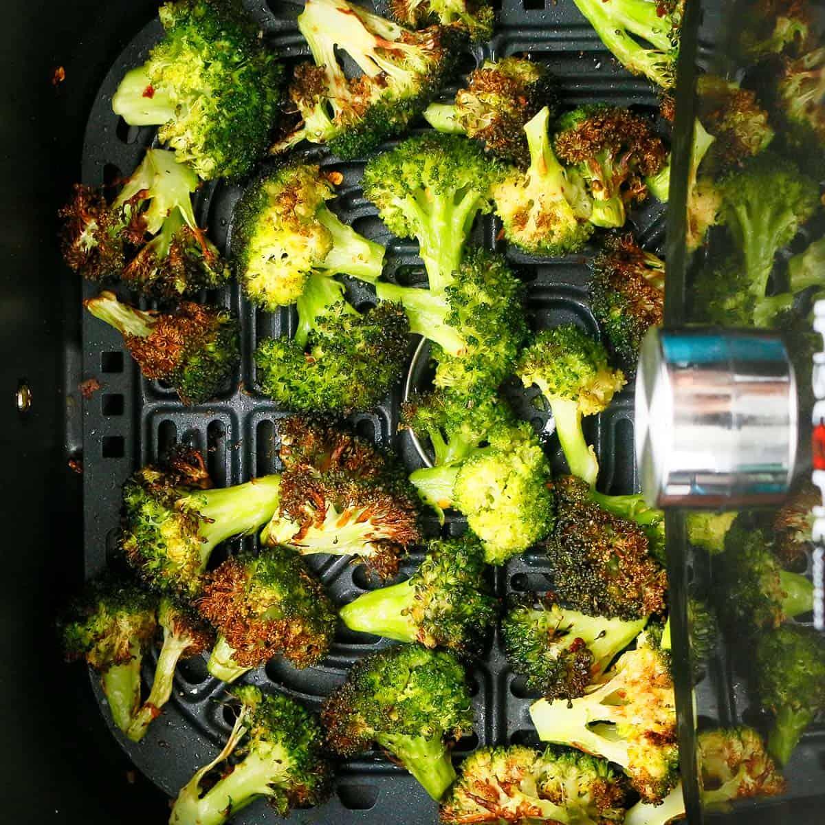 hot crispy air fried broccoli in an air fryer