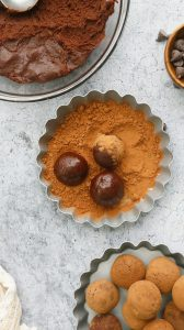 small tart with cocoa powder and 3 ingredient truffles in it for rolling
