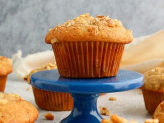 egg free banana muffin placed on a blue stand