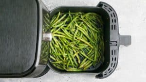 an open instant pot with cooked green beans