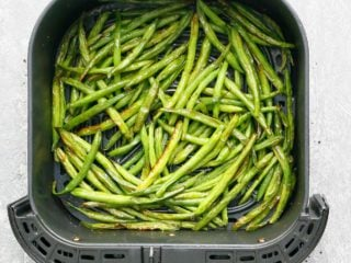 air fryer basket with crispy green beans