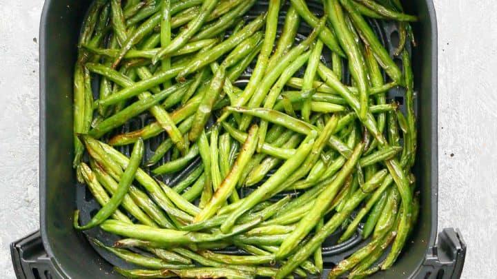 air fryer basket with crispy green beans