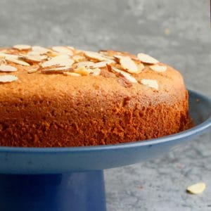 almond flour cake placed on a blue cake stand