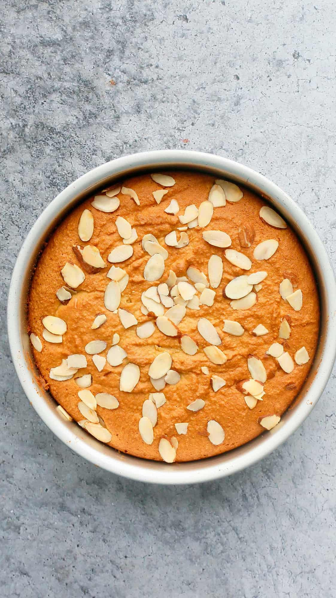 Freshly baked cake with almond flour and topped with sliced almonds