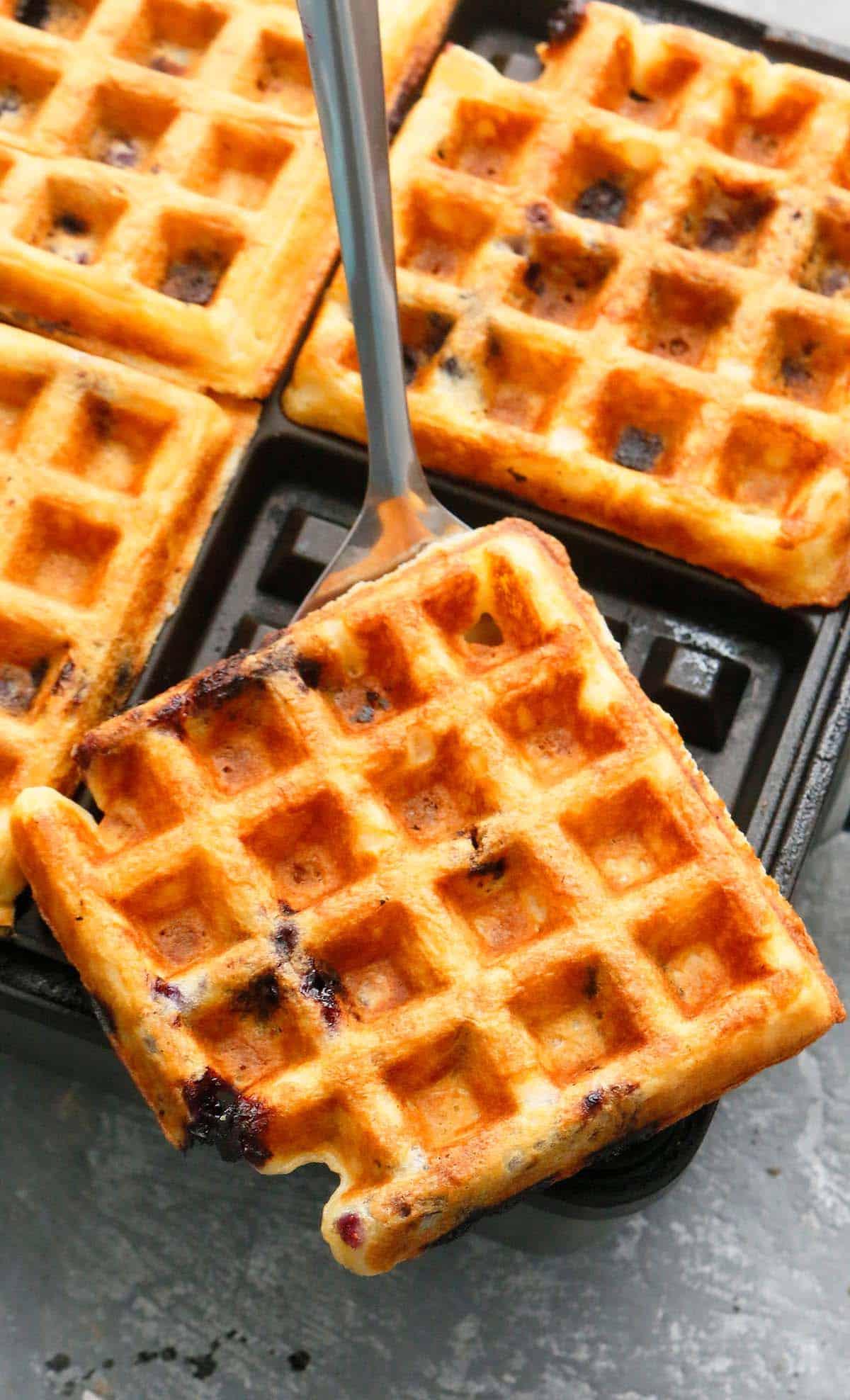 hot blueberry waffles on a waffle iron