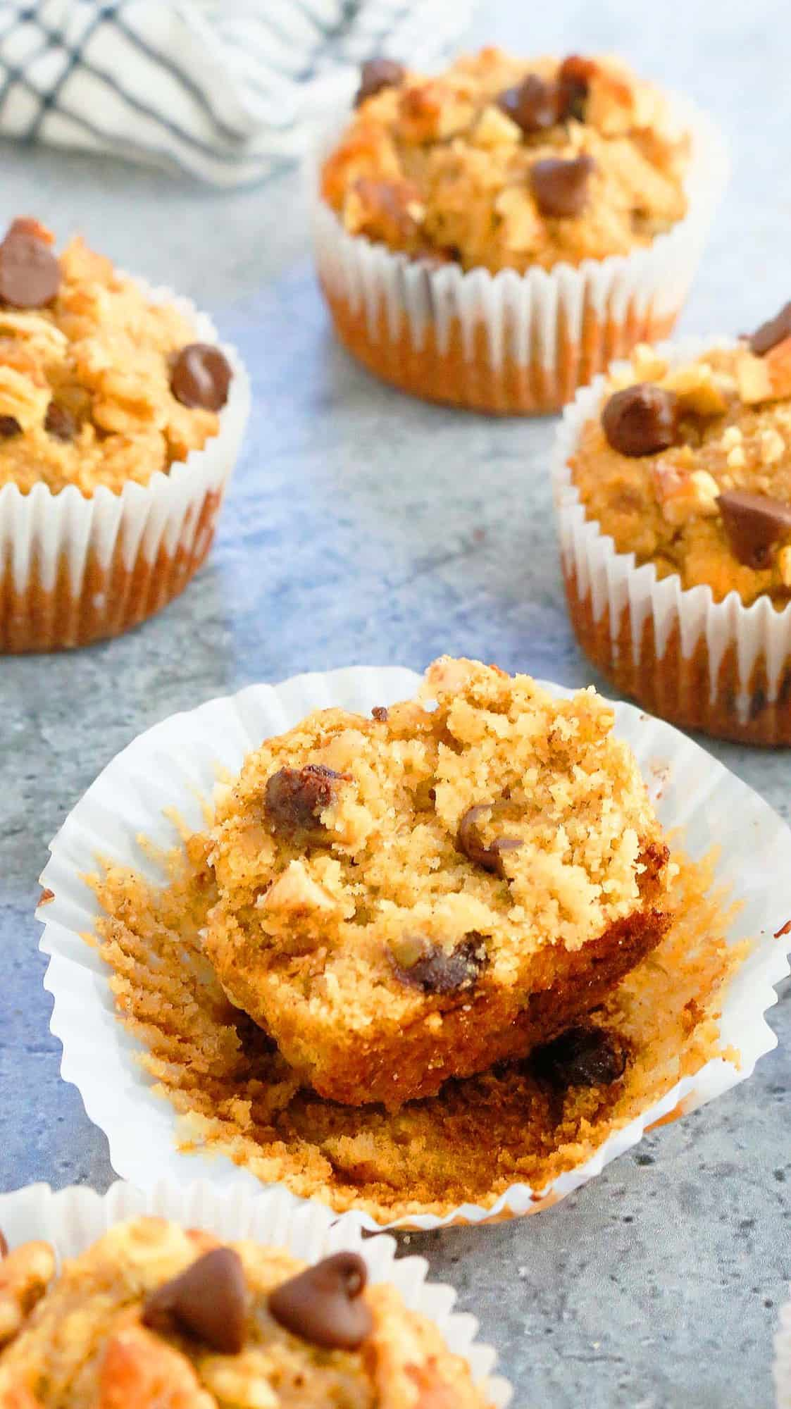 a split almond flour banana muffin along with more muffins