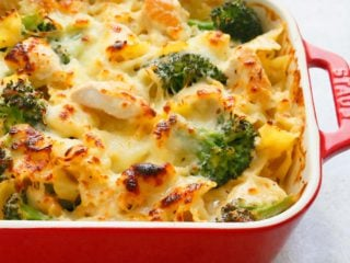 chicken broccoli pasta baked in a red pan