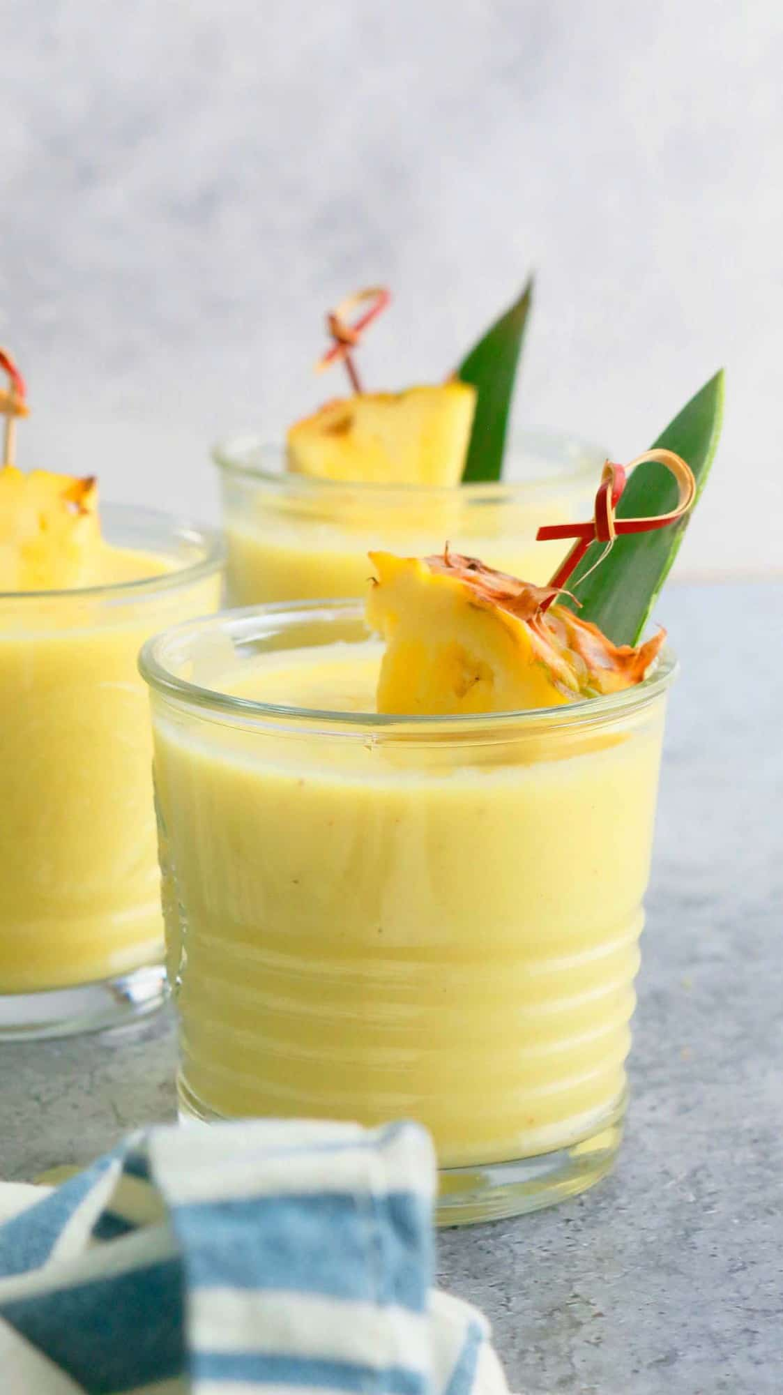 3 glasses filled with pina colada smoothie