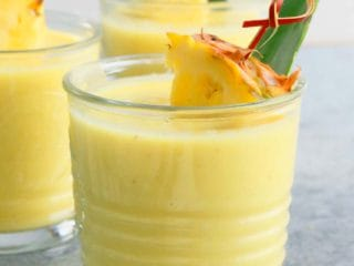 healthy pina colada smoothie in 3 glasses