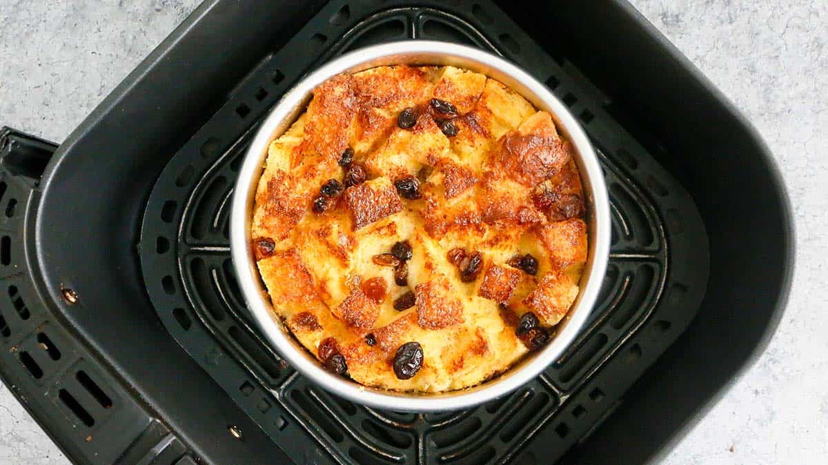 air fryer basket with baked bread pudding with raisins
