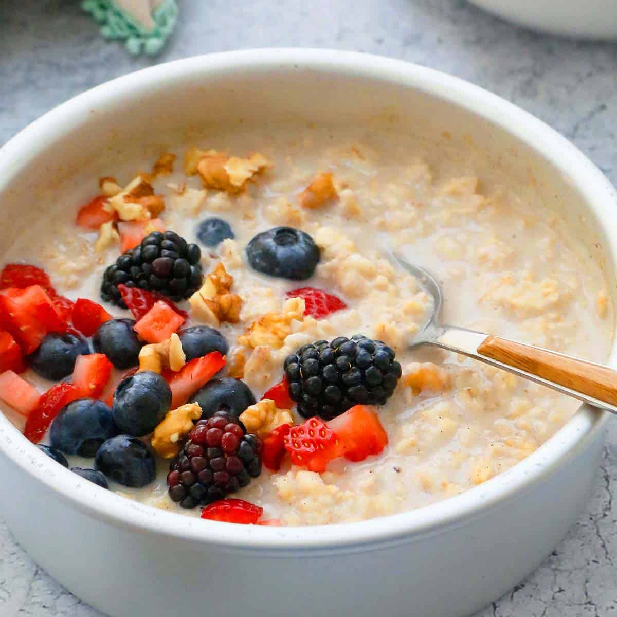 air fryer oatmeal in a pan topped with berries