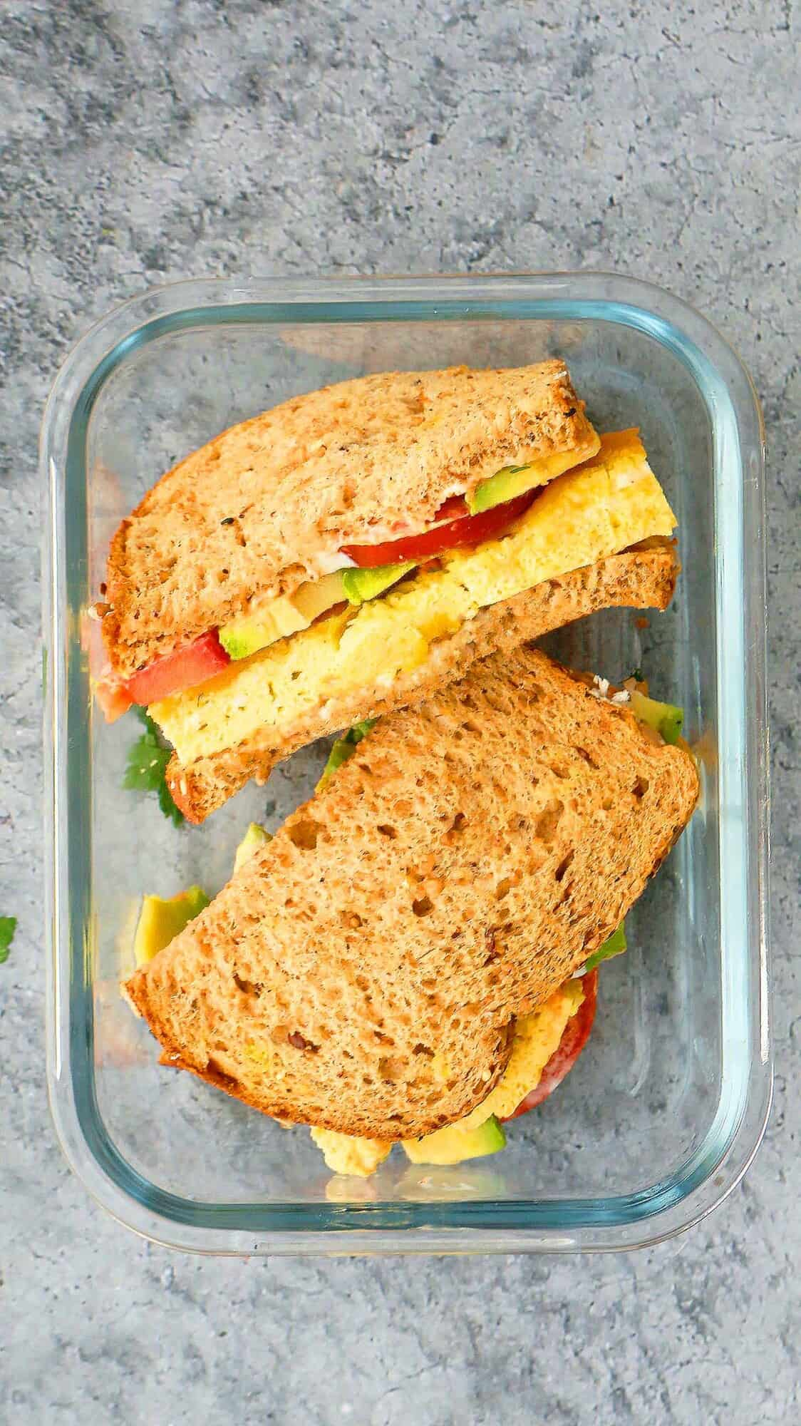 egg omelette sandwich with avocado in lunch box