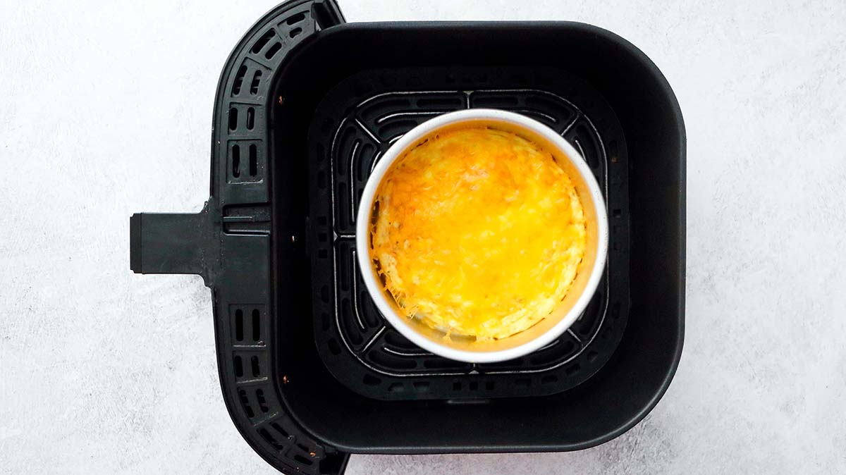 air fryer basket with freshly made omelette