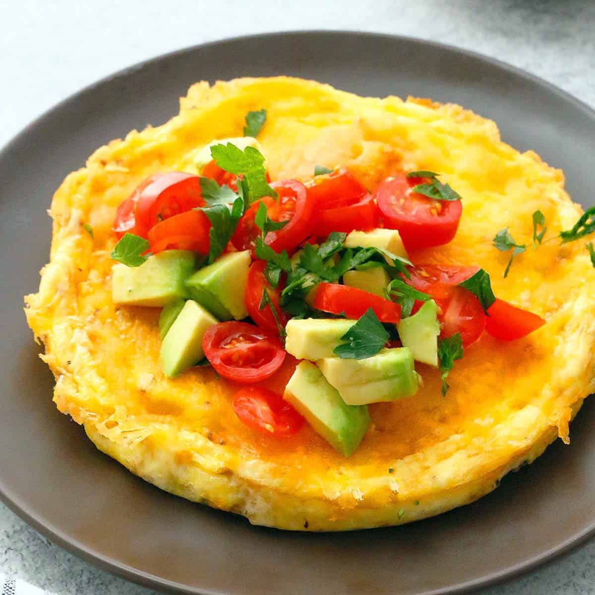 brown plate with cheesy egg omelette