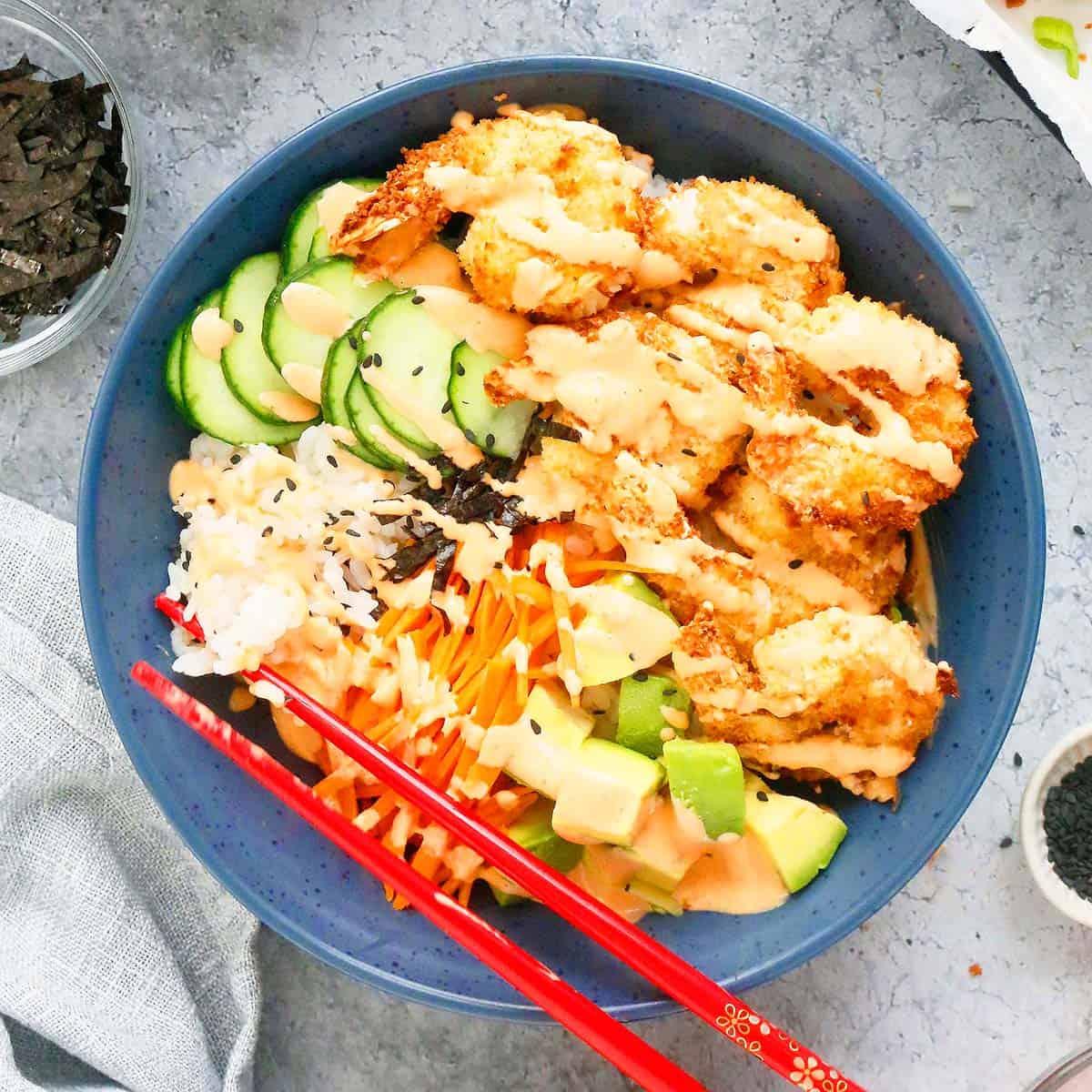 spicy shrimp sushi bowl with chopsticks