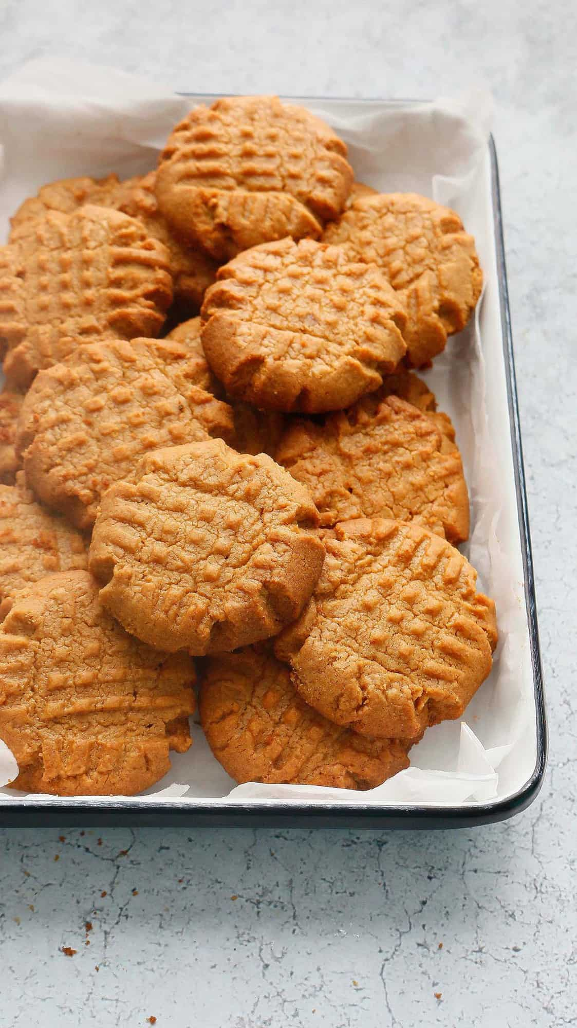 almond butter cookies on a white platter
