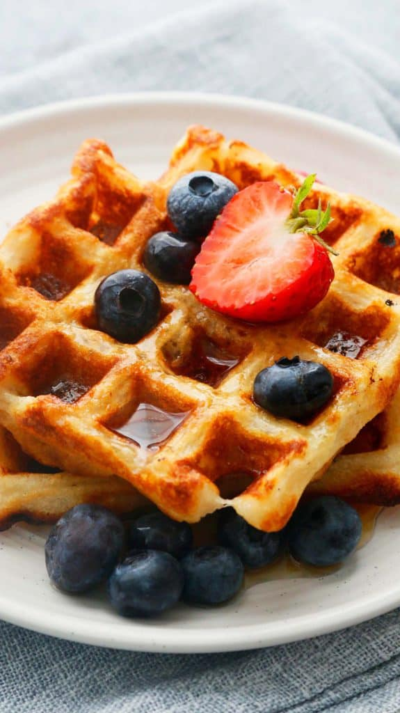 egg free waffles on a plate with maple syrup
