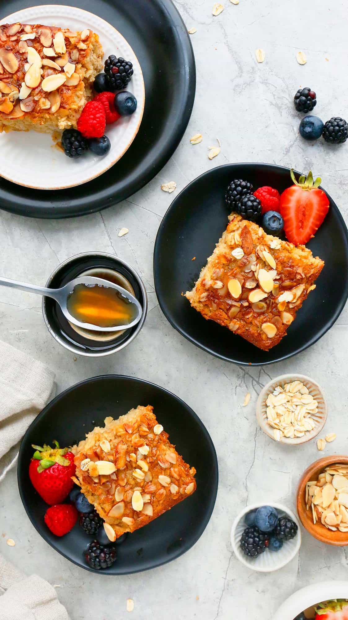 healthy served oatmeal squares served on black plates.