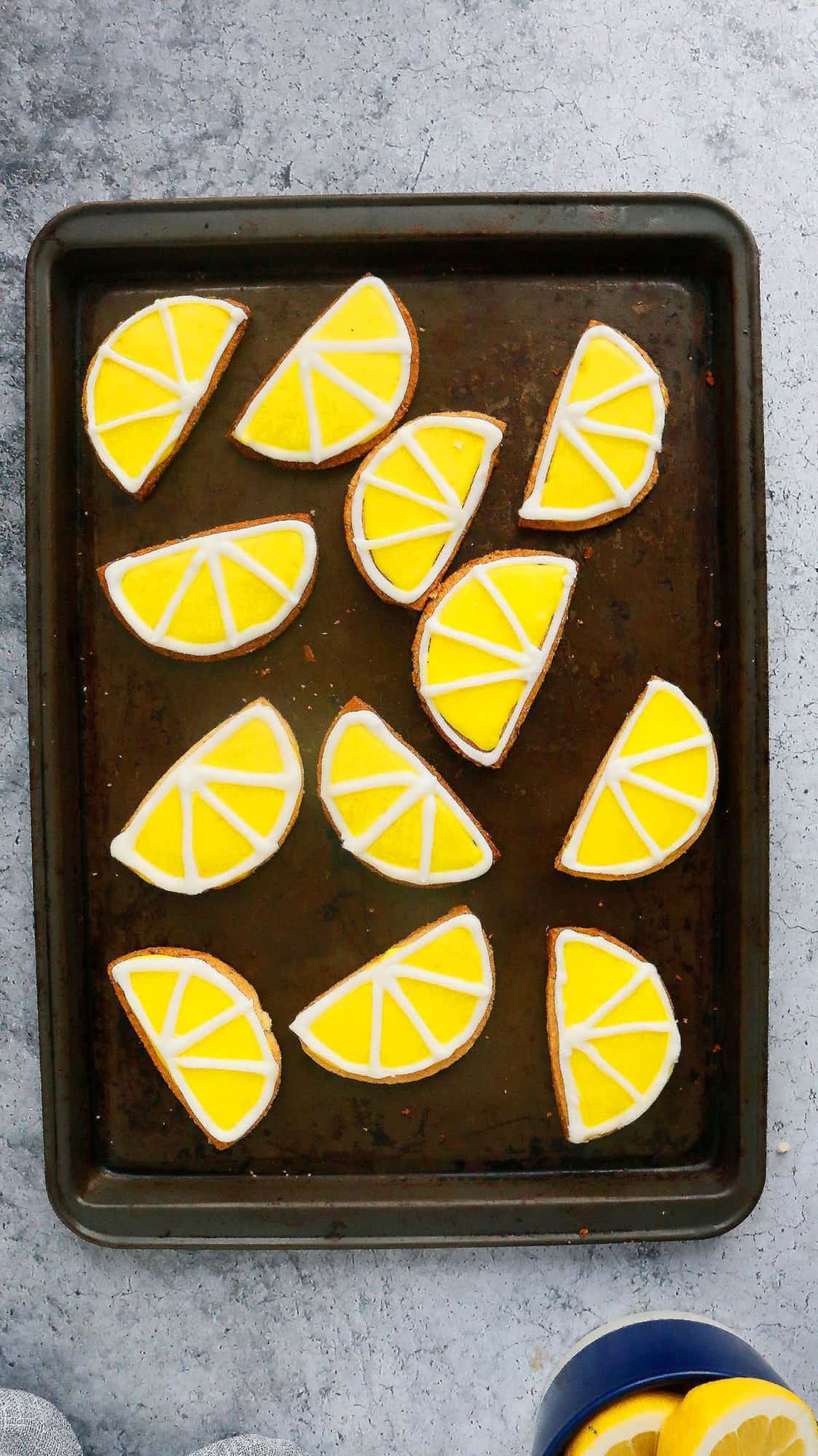 a cooking sheet with decorated cookies