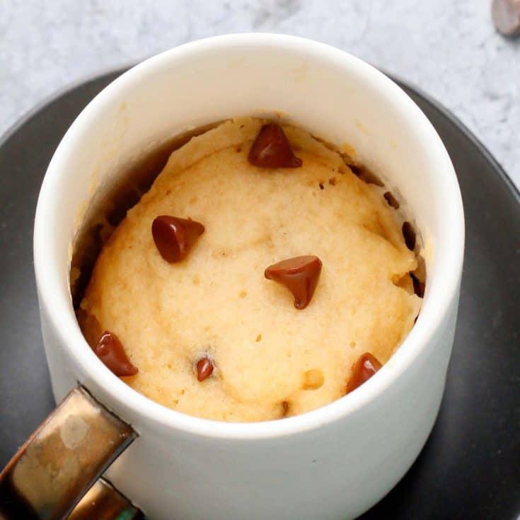 Vegan Mug cake with chocolate chips in a white mug