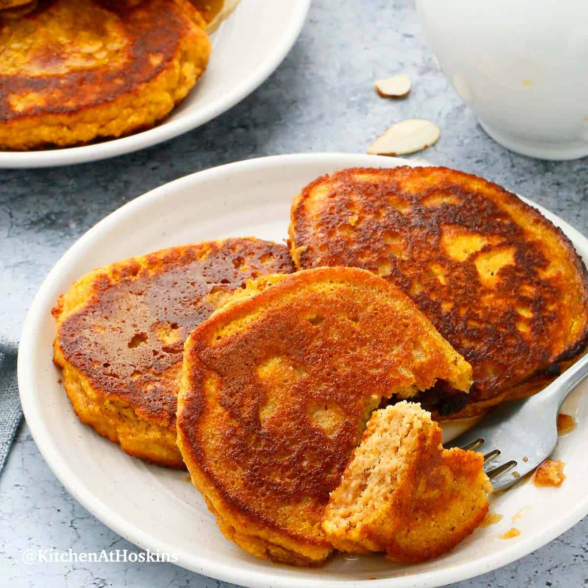 gluten free pumpkin pancakes in white plates