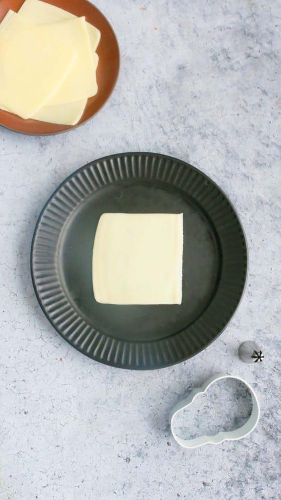slice of mozzarella cheese on a black plate